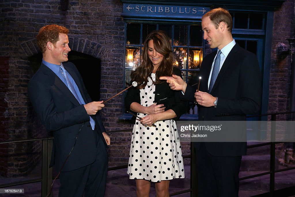 Prince Harry, Catherine, Duchess of Cambridge and Prince William, Duke of Cambridge share a joke on the set used to depict Diagon Alley in the Harry Potter Films during the Inauguration Of Warner Bros. Studios Leavesden on April 26, 2013 in London, England.
