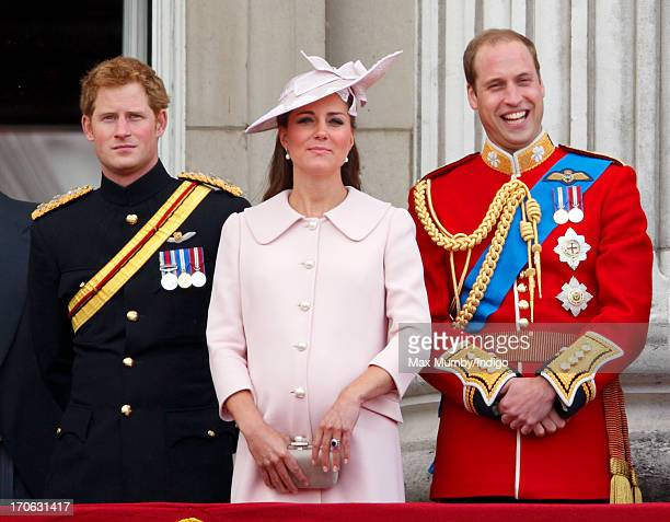 Prince Harry Catherine Duchess of Cambridge and Prince William Duke of Cambridge stand on the balcony of Buckingham Palace during the annual Trooping...