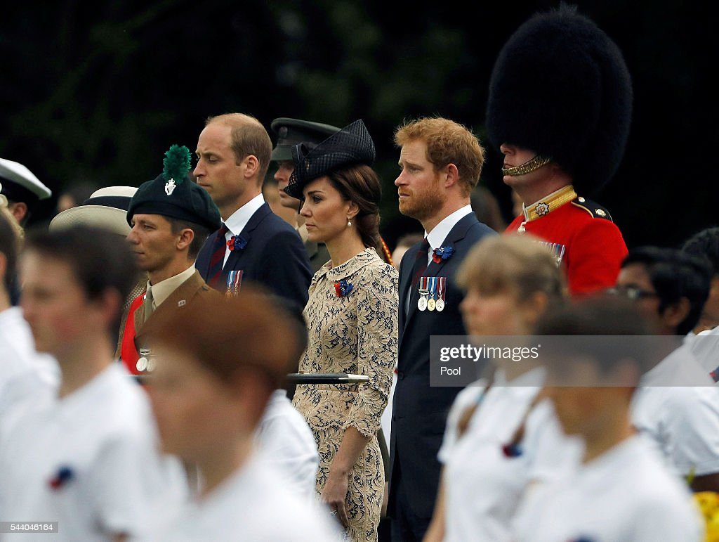 Prince Harry, Catherine, Duchess of Cambridge and Prince William, Duke of Cambridge walk during the 100th anniversary of the beginning of the Battle of the Somme at the Thiepval memorial to the Missing on July 1, 2016 in Thiepval, France. The event is part of the Commemoration of the Centenary of the Battle of the Somme at the Commonwealth War Graves Commission Thiepval Memorial in Thiepval, France, where 70,000 British and Commonwealth soldiers with no known grave are commemorated.