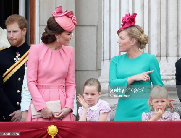 Prince Harry Catherine Duchess of Cambridge Autumn Phillips and Isla Phillips look out from the balcony of Buckingham Palace during the Trooping the...