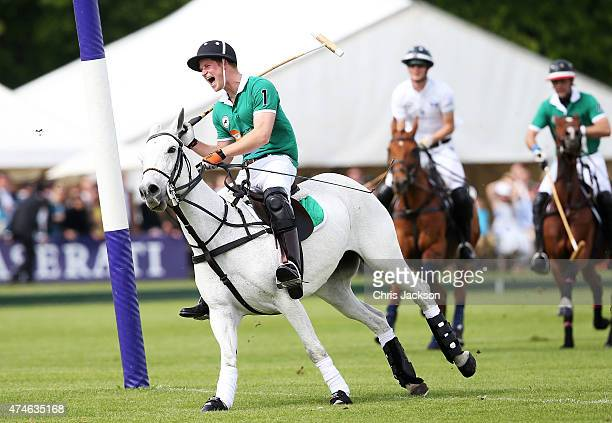 Prince Harry celebrates after scoring a goal during the Maserati Jerudong Park Trophy at Cirencester Park Polo Club on May 24 2015 in Cirencester...