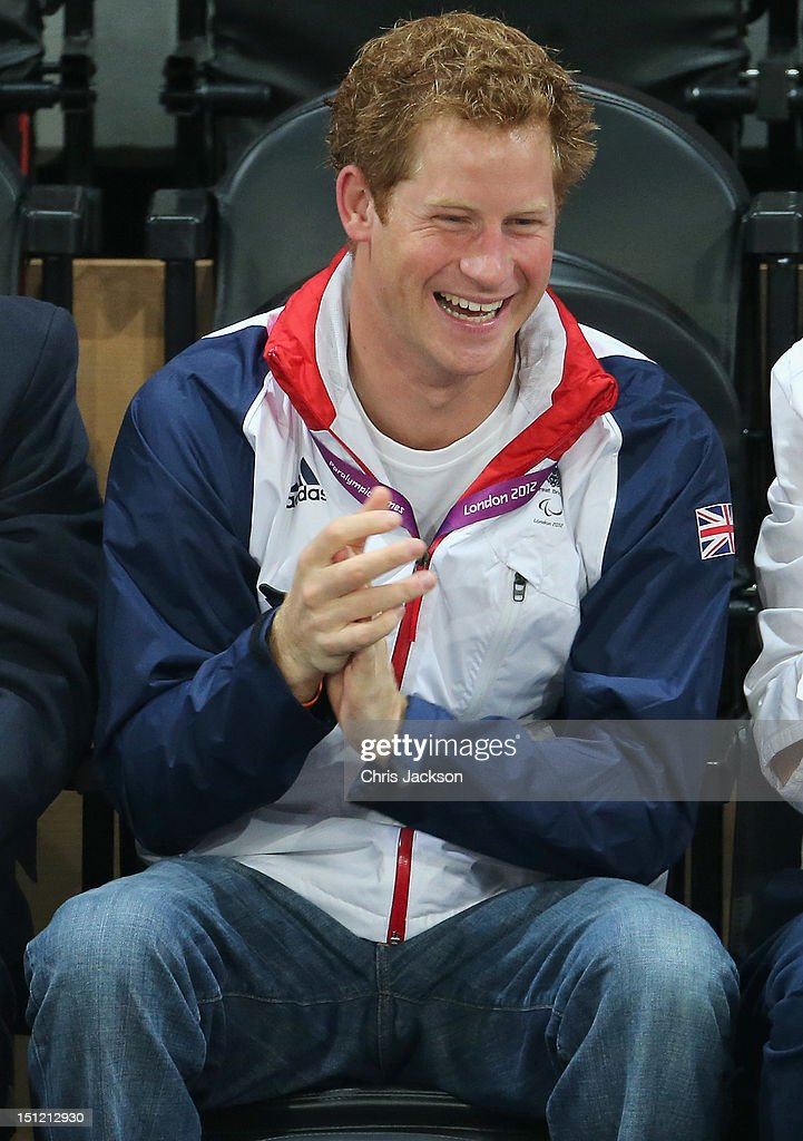 Prince Harry celebrates as Team GB scores as he attends the Goalball on day 6 of the London 2012 Paralympic Games at The Copper Box on September 4, 2012 in London, England.