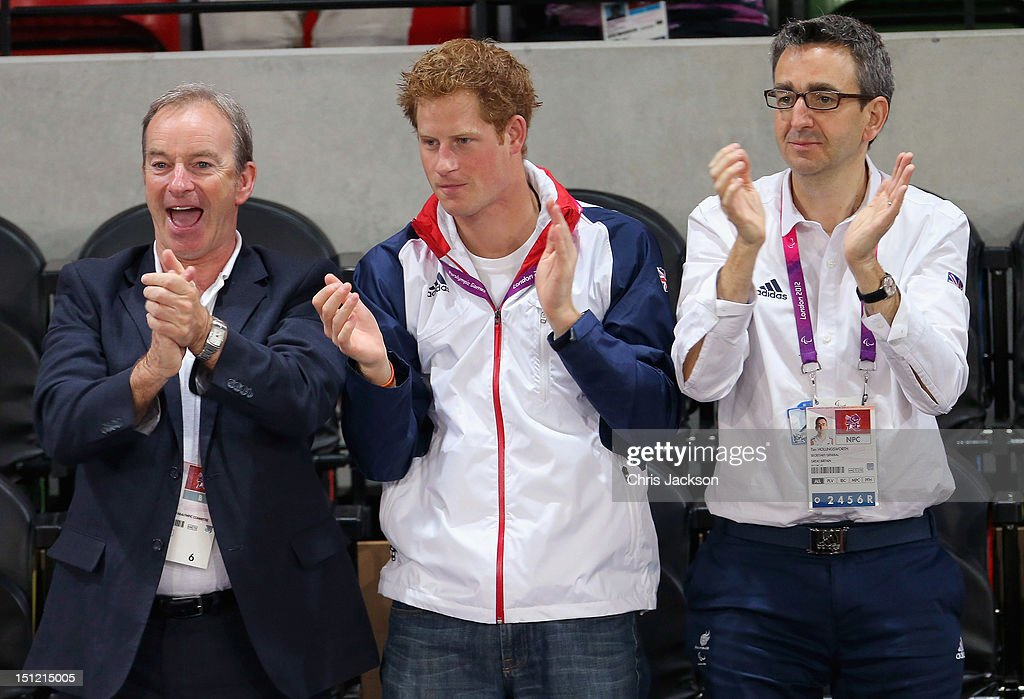 Prince Harry celebrates as Team GB scores as he attends the Goalball with British Paralympic Association chief executive Tim Hollingsworth (R) on day 6 of the London 2012 Paralympic Games at The Copper Box on September 4, 2012 in London, England.