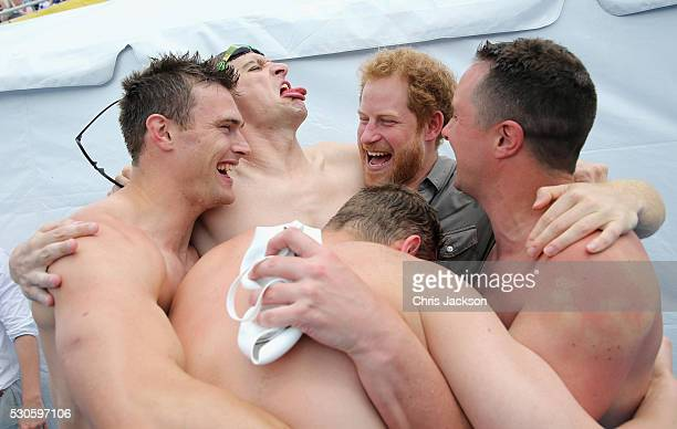 Prince Harry celebrates with UK Armed Forces Team Captain David Wiseman and the 4 x 50m Relay team who won gold at the swimming pool during the...