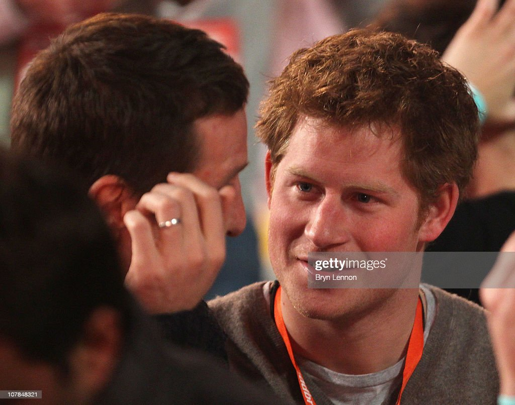 Prince Harry chats former England rugby player Will Greenwood attends the semi finals of the 2011 Ladbrokes.com World Darts Championship at Alexandra Palace on January 2, 2011 in London, England.