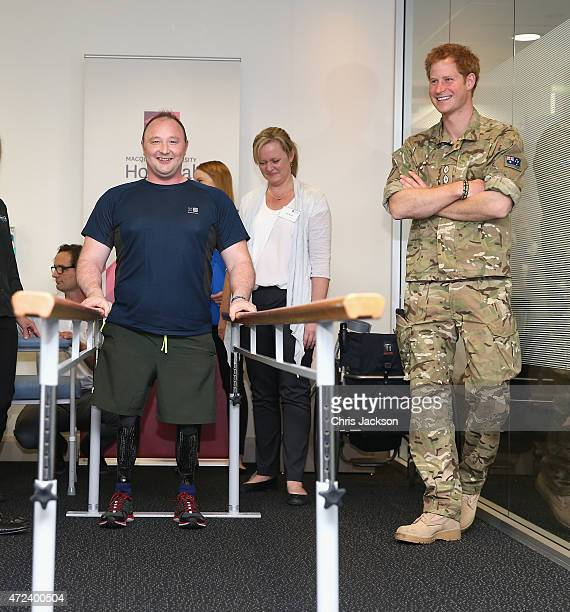 Prince Harry chats to British soldier Lt Alistair Spearing who is undergoing groundbreaking treatment to fit prosthetic legs at Macquarie University...