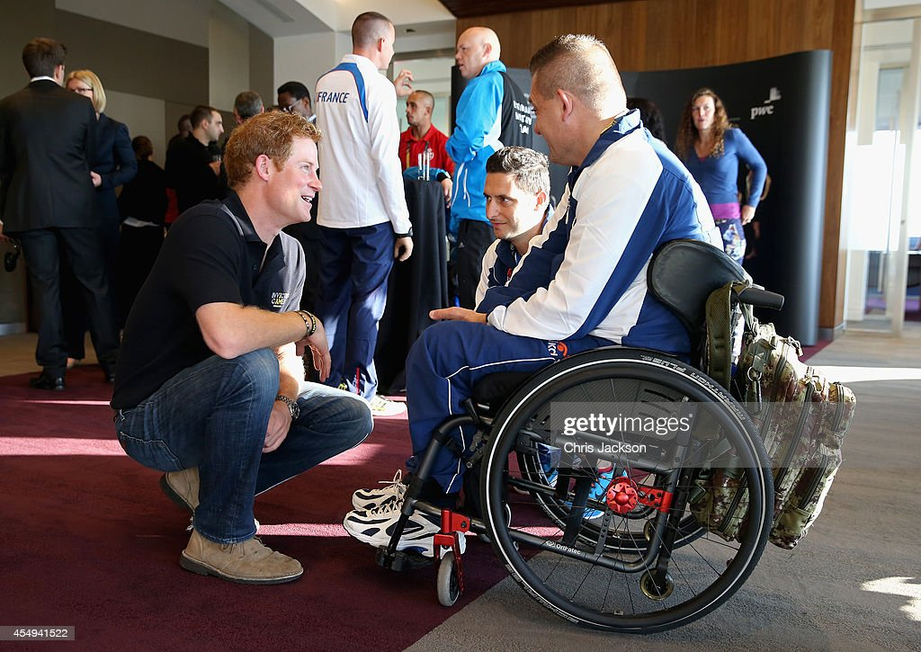 Prince Harry chats to competitors as he welcomes the Team Captains of the 13 nations taking part in the Invictus Games to London at PWC Embankment Place . The International sports event for 'wounded warriors', presented by Jaguar Land Rover, is just days away with limited last-minute tickets available at www.invictusgames.org on September 8, 2014 in London, England.