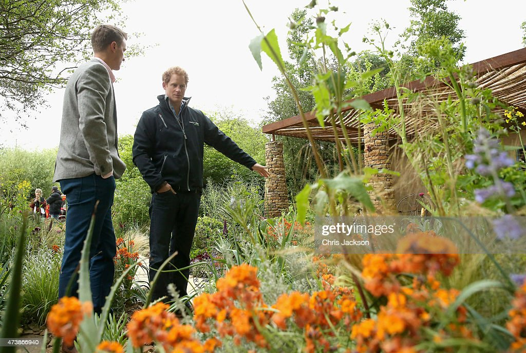 Prince Harry chats to designer Matt Keightley as he visits the Sentebale 'Hope In Vunerability' Garden during the annual Chelsea Flower show at Royal Hospital Chelsea on May 18, 2015 in London, England.The Sentebale - Hope In Vulnerability Garden at RHS Chelsea Flower Show was designed by Matt Keightley and is inspired by the Mamohato Children's Centre in Lesotho. The Children's Centre is due to open later this year in Lesotho and will provide support to children living wth HIV