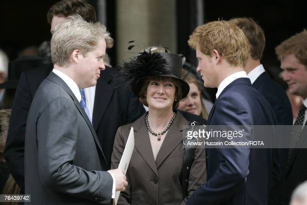 Prince Harry chats to Earl Spencer and Lady Sarah McCorquodale after the Service to celebrate the life of Diana Princess of Wales at the Guards...