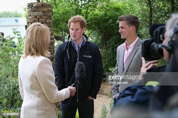 Prince Harry chats to Louise Minchin from BBC Breakfast as they visit the Sentebale 'Hope In Vunerability' Garden during the annual Chelsea Flower...