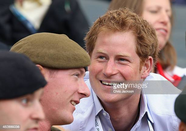 Prince Harry chats to soldiers as he watches the athletics at Hampden Park during the Commonwealth Games on July 29 2014 in Glasgow Scotland