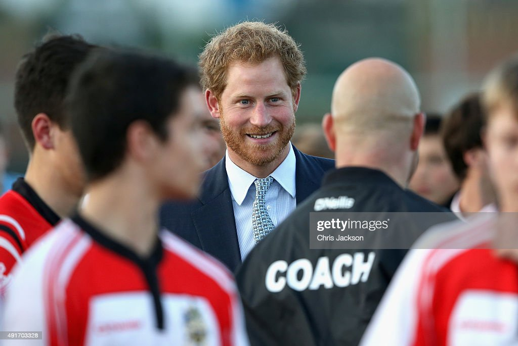 Prince Harry chats to staff and players during a visit to Paignton Rugby Club on October 7, 2015 in Paignton, England. Prince Harry is visiting the club in support of the RFU's World Cup Legacy programmes.