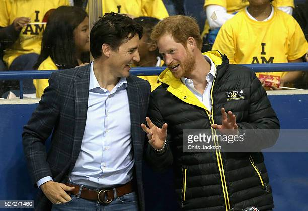 Prince Harry chats with Canadian Prime Minister Justin Trudeau as they watch a sledgehockey match Mattany at the Athletic Centre on May 2 2016 in...