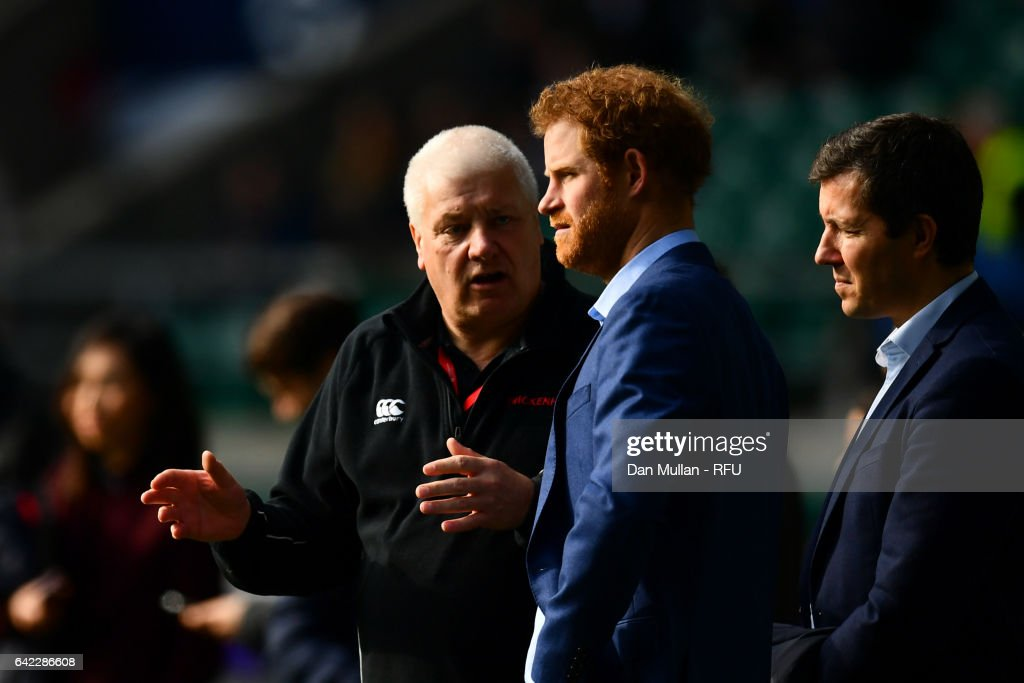 Prince Harry chats with head groundsman Keith Kent during an England open training session at Twickenham Stadium on February 17, 2017 in London, England.