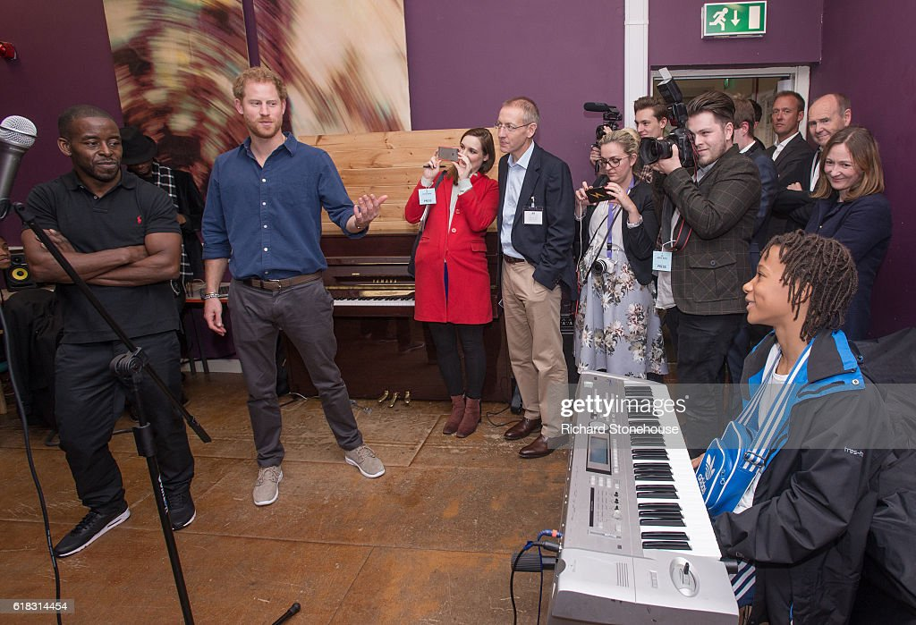 Prince Harry chats with teenagers in one of the Music Studios during his visit the Community Recording Studio at Russell Youth Centre on October 26, 2016 in Nottingham, United Kingdom. The Royal Foundation is working with Epic Partners and the Community Recording Studio (CRS) to deliver Full Effect: a project to improve the opportunities for young people and reduce youth violence in St. Ann's, Nottingham.
