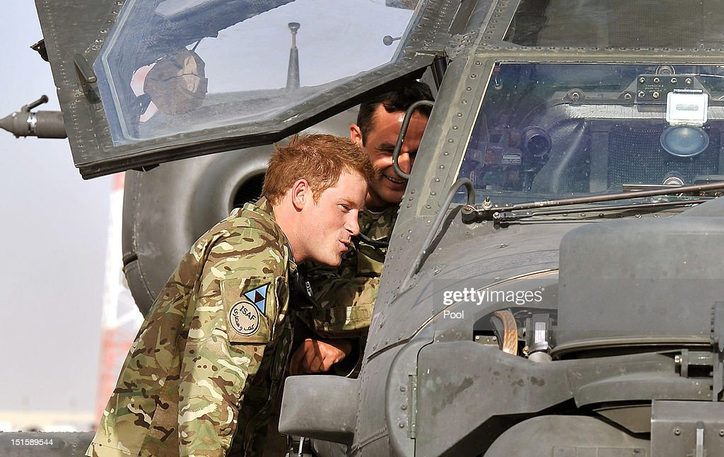 <a gi-track='captionPersonalityLinkClicked' href=/galleries/search?phrase=Prince+Harry&family=editorial&specificpeople=178173 ng-click='$event.stopPropagation()'>Prince Harry</a> climbs up to examine the cockpit of an Apache helicopter with a member of his squadron (name not provided) on September 7, 2012 at Camp Bastion, Afghanistan. <a gi-track='captionPersonalityLinkClicked' href=/galleries/search?phrase=Prince+Harry&family=editorial&specificpeople=178173 ng-click='$event.stopPropagation()'>Prince Harry</a> has been redeployed to the region to pilot attack helicopters.