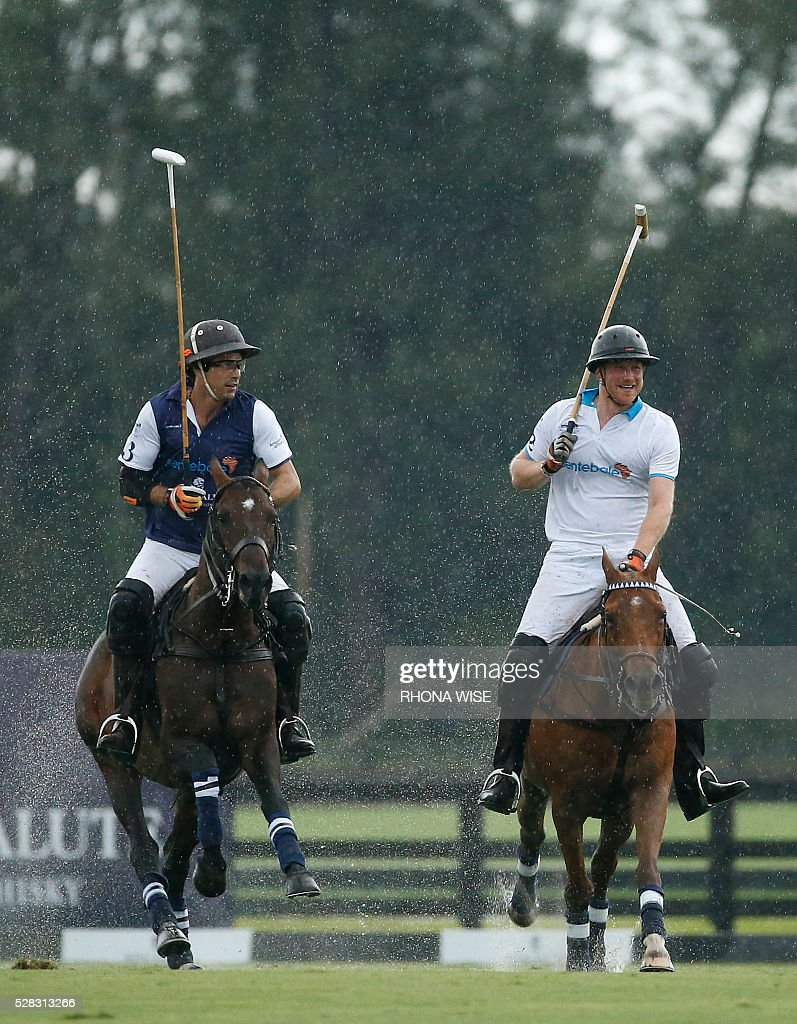 Prince Harry (R) competes against Nacho Blaquier (R) during the Sentebale Royal Salute Polo Cup 2016 at the Valiente Polo Farm in Wellington, Florida on May 4, 2016. / AFP / RHONA