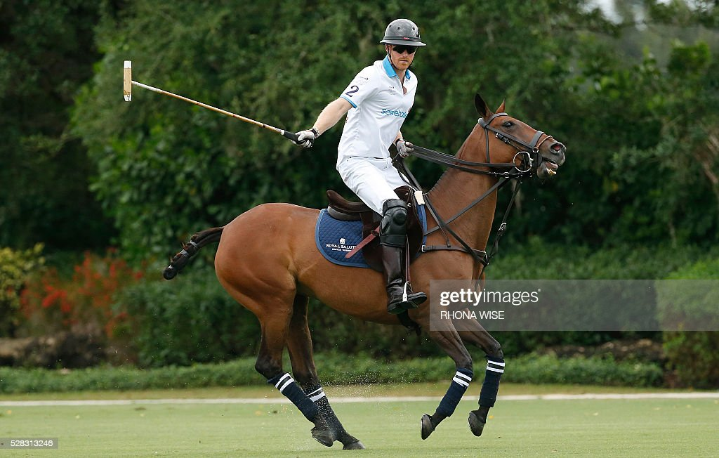 Prince Harry competes during the Sentebale Royal Salute Polo Cup 2016 at the Valiente Polo Farm in Wellington, Florida on May 4, 2016. / AFP / RHONA