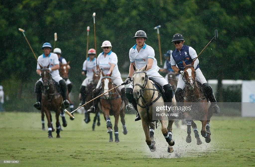 Prince Harry (2R) competes during the Sentebale Royal Salute Polo Cup 2016 at the Valiente Polo Farm in Wellington, Florida on May 4, 2016. / AFP / RHONA