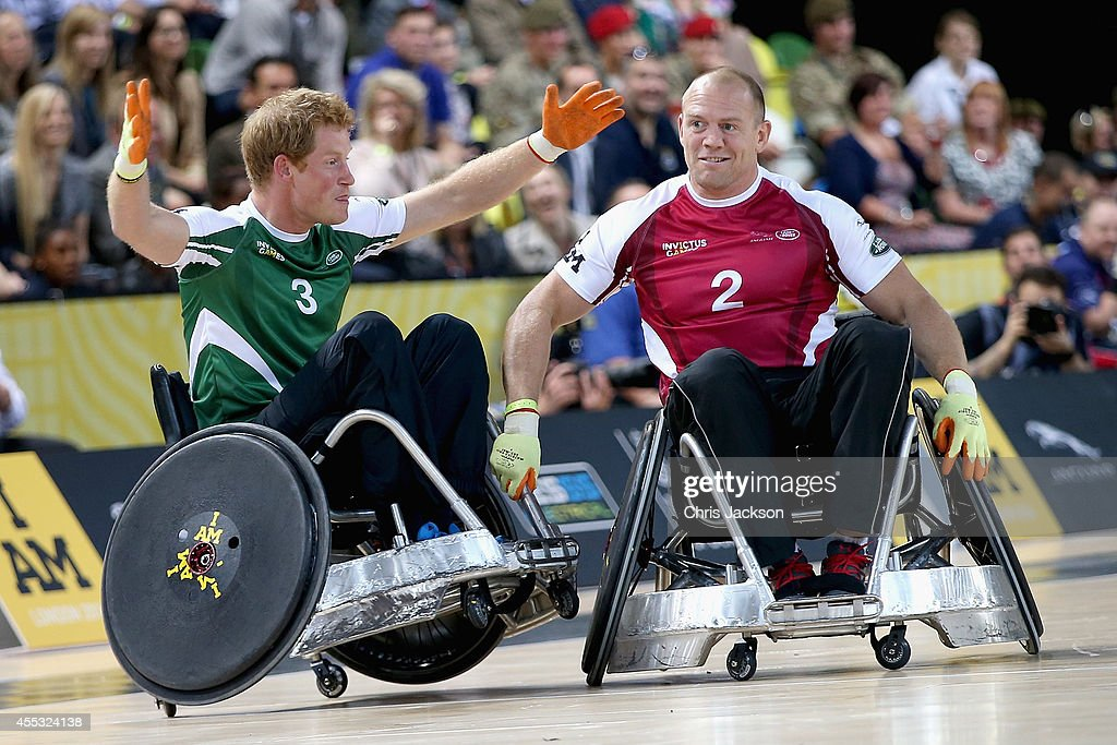 Prince Harry competes with Mike Tindall during an Exhibition wheelchair rugby match at the Copper Box ahead of tonight's exhibition match as part of...