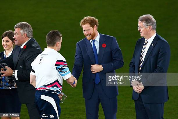 Prince Harry congratulates referee Nigel Owens of Wales following the 2015 Rugby World Cup Final match between New Zealand and Australia at...
