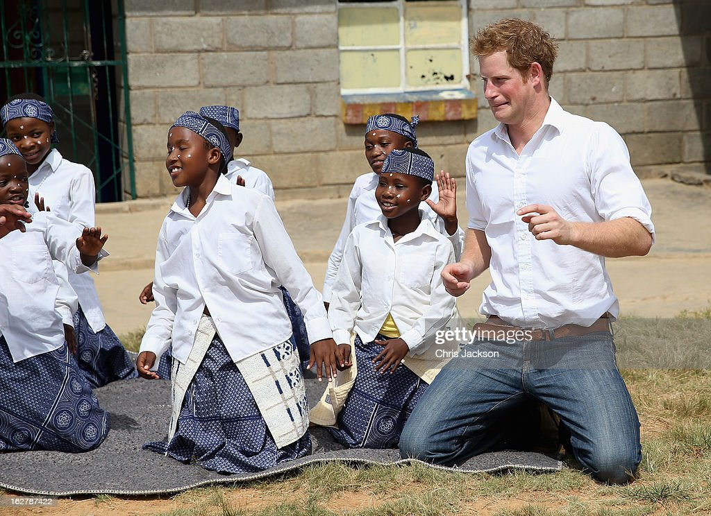 Prince Harry dances with deaf children during at visit to the Kananelo Centre for the deaf, a project supported by his charity Sentebale on February 27, 2013 in Maseru, Lesotho. Sentebale is a charity founded by Prince Harry and Prince Seeiso of Lesotho. It helps the most vulnerable children in Lesotho get the support they need to lead healthy and productive lives. Sentebale works with local grassroots organisations to help these children, the victims of extreme poverty and Lesotho's HIV/AIDS epidemic. Cathy Ferrier was appointed as Sentebale's Chief Executive in March 2012 and is spearheading a fundraising initiative to build the Mamohato Centre which will provide psychosocial support for children and young people infected with HIV. Prince Harry is due to pay a visit to Lesotho this week to catch up on his charity's progress and meet key children who will be supported by the charity.