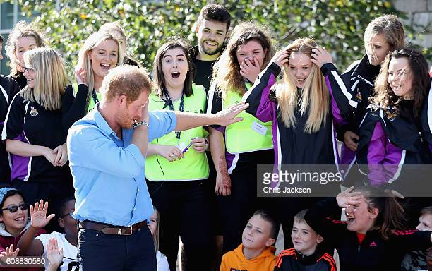 Prince Harry does 'the dab' with children from the Streetsport initiative during a visit to Robert Gordon University on September 20 2016 in Aberdeen...