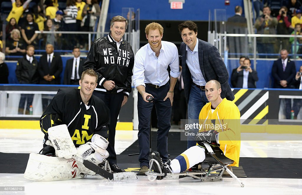 <a gi-track='captionPersonalityLinkClicked' href=/galleries/search?phrase=Prince+Harry&family=editorial&specificpeople=178173 ng-click='$event.stopPropagation()'>Prince Harry</a> drops the puck in as Canadian Prime Minister <a gi-track='captionPersonalityLinkClicked' href=/galleries/search?phrase=Justin+Trudeau&family=editorial&specificpeople=2616495 ng-click='$event.stopPropagation()'>Justin Trudeau</a> looks on as they start a sledge-hockey match Mattany at the Athletic Centre on May 2, 2016 in Toronto, Canada. <a gi-track='captionPersonalityLinkClicked' href=/galleries/search?phrase=Prince+Harry&family=editorial&specificpeople=178173 ng-click='$event.stopPropagation()'>Prince Harry</a> is in Toronto for the Launch of the 2017 Toronto Invictus Games before heading down to Miami and the 2016 Invictus Games in Orlando.