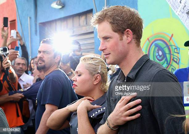 Prince Harry during a visit to 'Cracolandia' an extremely deprived area of Sao Paulo with a high concentration of crack addicts on June 26 2014 in...