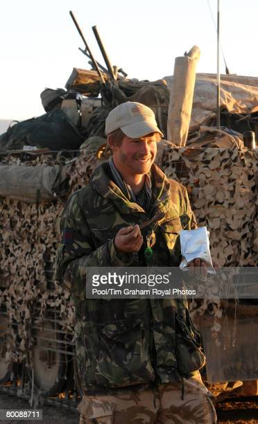 Prince Harry eats his boilinthebag lunch in the desert in Helmand province Southern Afghanistan on February 19 2008