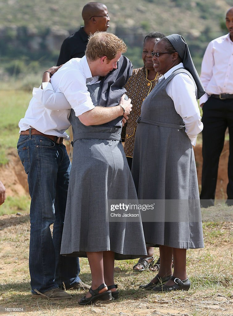 <a gi-track='captionPersonalityLinkClicked' href=/galleries/search?phrase=Prince+Harry&family=editorial&specificpeople=178173 ng-click='$event.stopPropagation()'>Prince Harry</a> embraces a woman as he visits the Kananelo Centre for the deaf, a project supported by his charity Sentebale on February 27, 2013 in Maseru, Lesotho. Sentebale is a charity founded by <a gi-track='captionPersonalityLinkClicked' href=/galleries/search?phrase=Prince+Harry&family=editorial&specificpeople=178173 ng-click='$event.stopPropagation()'>Prince Harry</a> and Prince Seeiso of Lesotho. It helps the most vulnerable children in Lesotho get the support they need to lead healthy and productive lives. Sentebale works with local grassroots organisations to help these children, the victims of extreme poverty and Lesotho's HIV/AIDS epidemic. Cathy Ferrier was appointed as Sentebale's Chief Executive in March 2012 and is spearheading a fundraising initiative to build the Mamohato Centre which will provide psychosocial support for children and young people infected with HIV. <a gi-track='captionPersonalityLinkClicked' href=/galleries/search?phrase=Prince+Harry&family=editorial&specificpeople=178173 ng-click='$event.stopPropagation()'>Prince Harry</a> is due to pay a visit to Lesotho this week to catch up on his charity's progress and meet key children who will be supported by the charity.