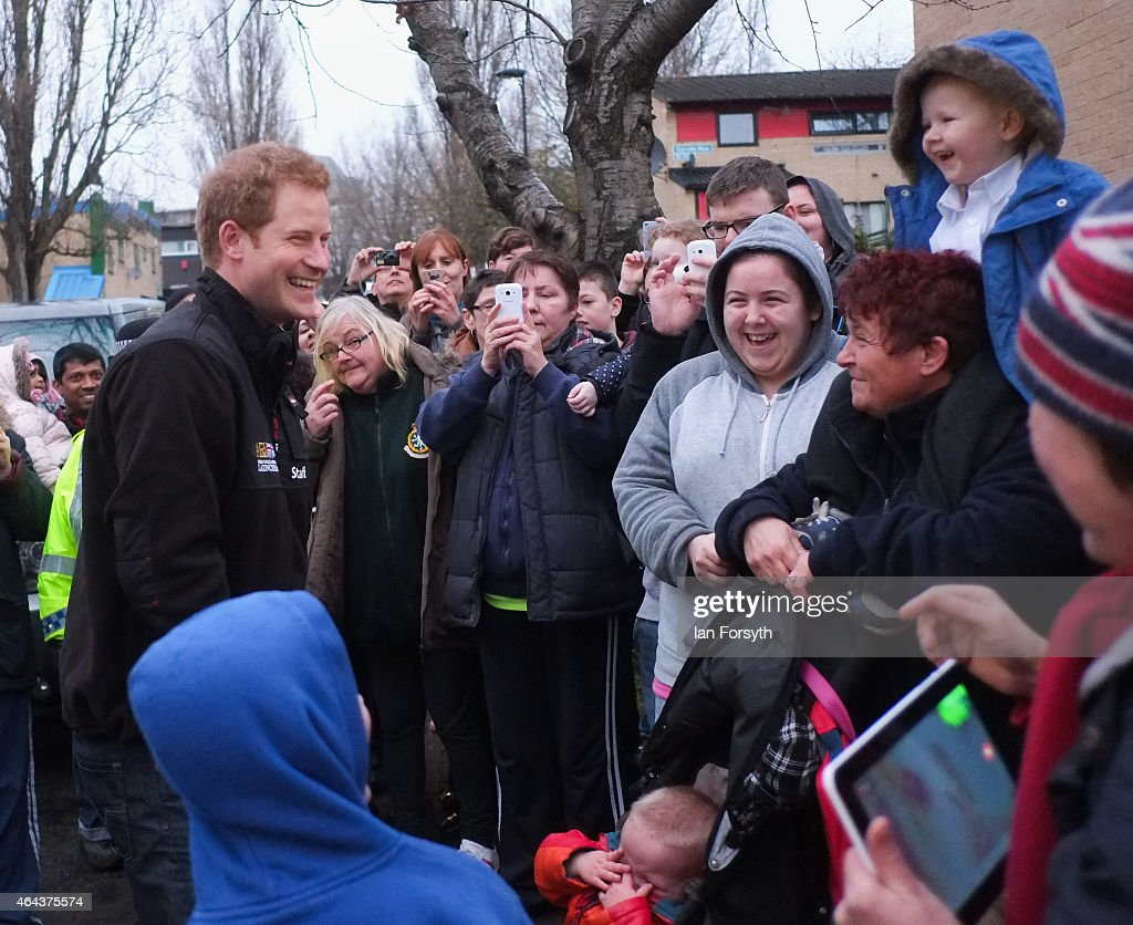 Prince Harry entertains the waiting crowd during a visit to the charity Armed Forces and Veterans Launchpad at Avondale House on February 25, 2015 in Newcastle upon Tyne, England. The charity provides accommodation and support for Armed Forces veterans who are making the transition into civilian life.