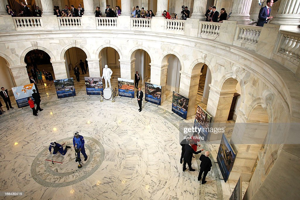 Prince Harry (2nd L), escorted by HALO Trust Director Guy Willoughby (L) and his wife Fiona Willoughby (3rd L), and U.S. Senator John McCain (R-AZ) (R), tours an exhibit on landmines and unexploded ordnances inside the Rotunda of Russell Senate Office Building on Capitol Hill during the first day of his visit to the United States May 9, 2013 in Washington, DC. HRH will be undertaking engagements on behalf of charities with which the Prince is closely associated on behalf also of HM Government, with a central theme of supporting injured service personnel from the UK and US forces.