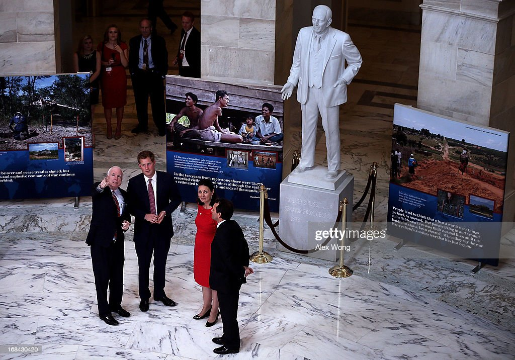 Prince Harry (2nd L), escorted by HALO Trust Director Guy Willoughby (R) and his wife Fiona Willoughby (3rd L), and U.S. Senator John McCain (R-AZ) (L), tours an exhibit on landmines and unexploded ordnances inside the Rotunda of Russell Senate Office Building on Capitol Hill during the first day of his visit to the United States May 9, 2013 in Washington, DC. HRH will be undertaking engagements on behalf of charities with which the Prince is closely associated on behalf also of HM Government, with a central theme of supporting injured service personnel from the UK and US forces.
