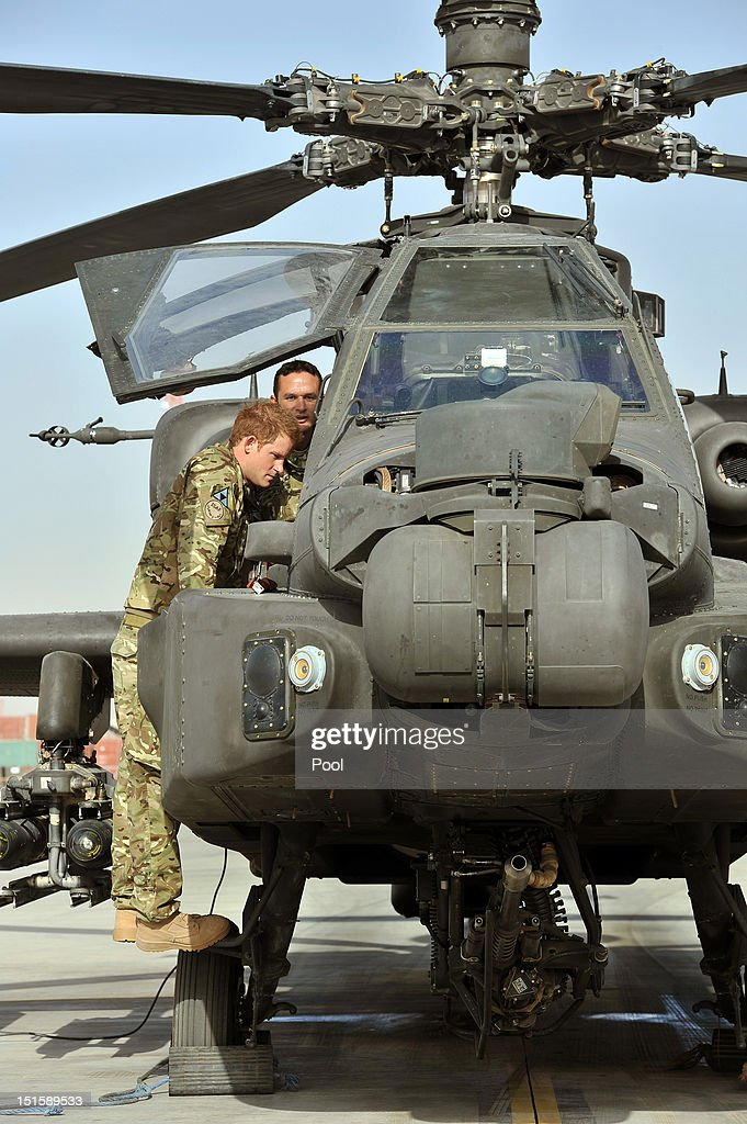 <a gi-track='captionPersonalityLinkClicked' href=/galleries/search?phrase=Prince+Harry&family=editorial&specificpeople=178173 ng-click='$event.stopPropagation()'>Prince Harry</a> examines the 30mm cannon of an Apache helicopter with a member of his squadron (name not provided) on September 7, 2012 at Camp Bastion, Afghanistan. <a gi-track='captionPersonalityLinkClicked' href=/galleries/search?phrase=Prince+Harry&family=editorial&specificpeople=178173 ng-click='$event.stopPropagation()'>Prince Harry</a> has been redeployed to the region to pilot attack helicopters.