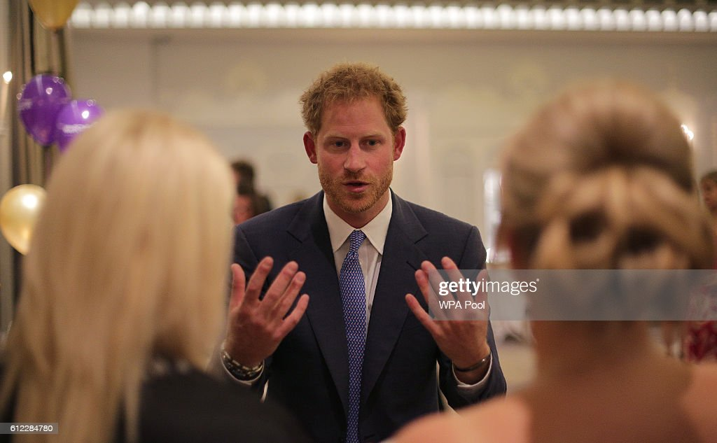 prince-harry-gestures-as-he-as-he-talks-to-guests-as-they-attend-the-picture-id612284780