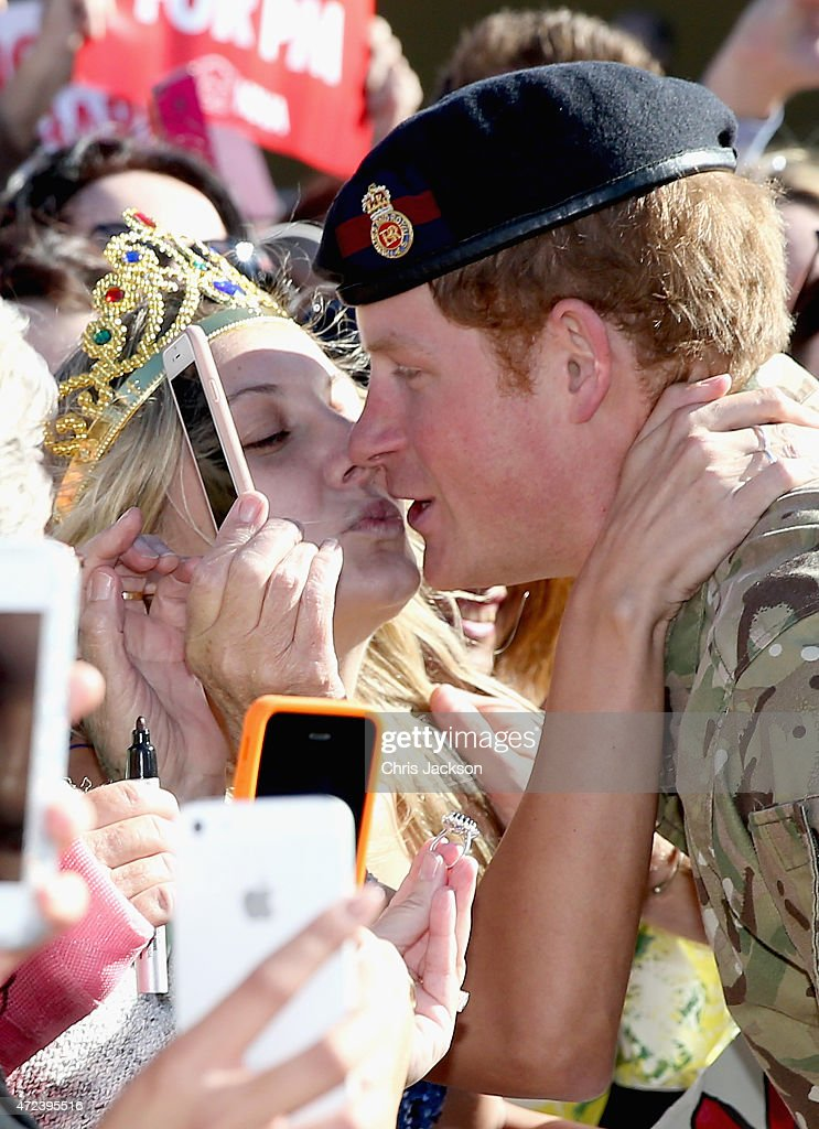 <a gi-track='captionPersonalityLinkClicked' href=/galleries/search?phrase=Prince+Harry&family=editorial&specificpeople=178173 ng-click='$event.stopPropagation()'>Prince Harry</a> gets kissed by Royal Fan Victoria Mcrae during a walkabout outside the Sydney Opera House on May 7, 2015 in Sydney, Australia. <a gi-track='captionPersonalityLinkClicked' href=/galleries/search?phrase=Prince+Harry&family=editorial&specificpeople=178173 ng-click='$event.stopPropagation()'>Prince Harry</a> is visiting Sydney following a month-long deployment with the Australian Army.