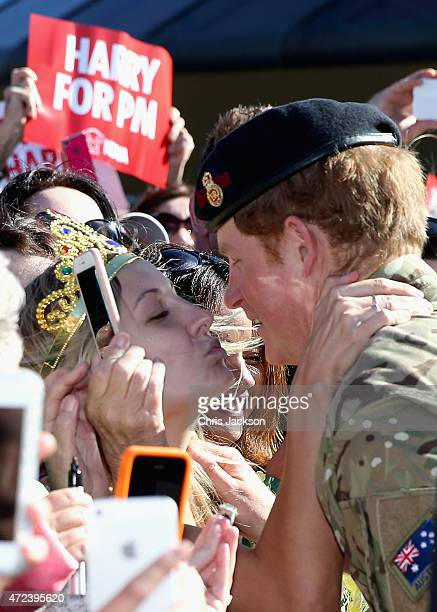 Prince Harry gets kissed by Royal Fan Victoria Mcrae during a walkabout outside the Sydney Opera House on May 7 2015 in Sydney Australia Prince Harry...