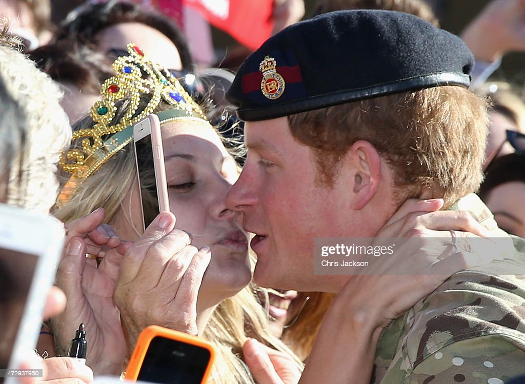 Prince Harry gets kissed by Royal Fan Victoria McRae during a walkabout outside the Sydney Opera House on May 7, 2015 in Sydney, Australia. Prince Harry is visiting Sydney following a month-long deployment with the Australian Army.