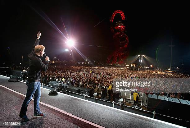 Prince Harry gives a speech on stage at the Invictus Games Closing Ceremony during the Invictus Games at Queen Elizabeth park on September 14 2014 in...