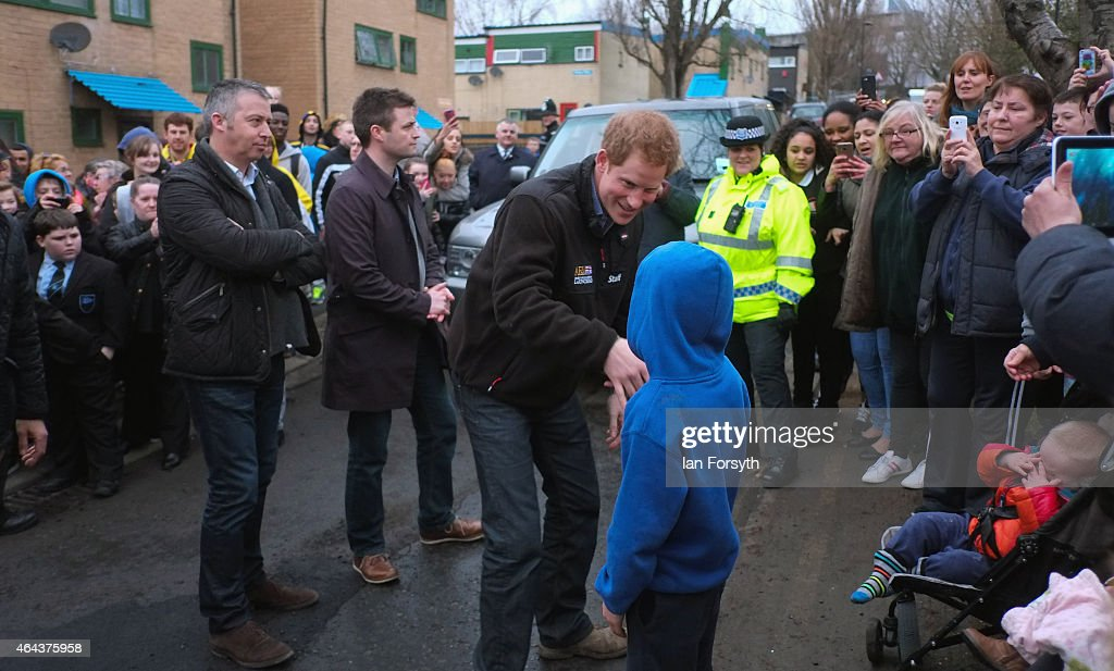 Prince Harry greets a young boy from the waiting crowd during a visit to the charity Armed Forces and Veterans Launchpad at Avondale House on February 25, 2015 in Newcastle upon Tyne, England. The charity provides accommodation and support for Armed Forces veterans who are making the transition into civilian life.