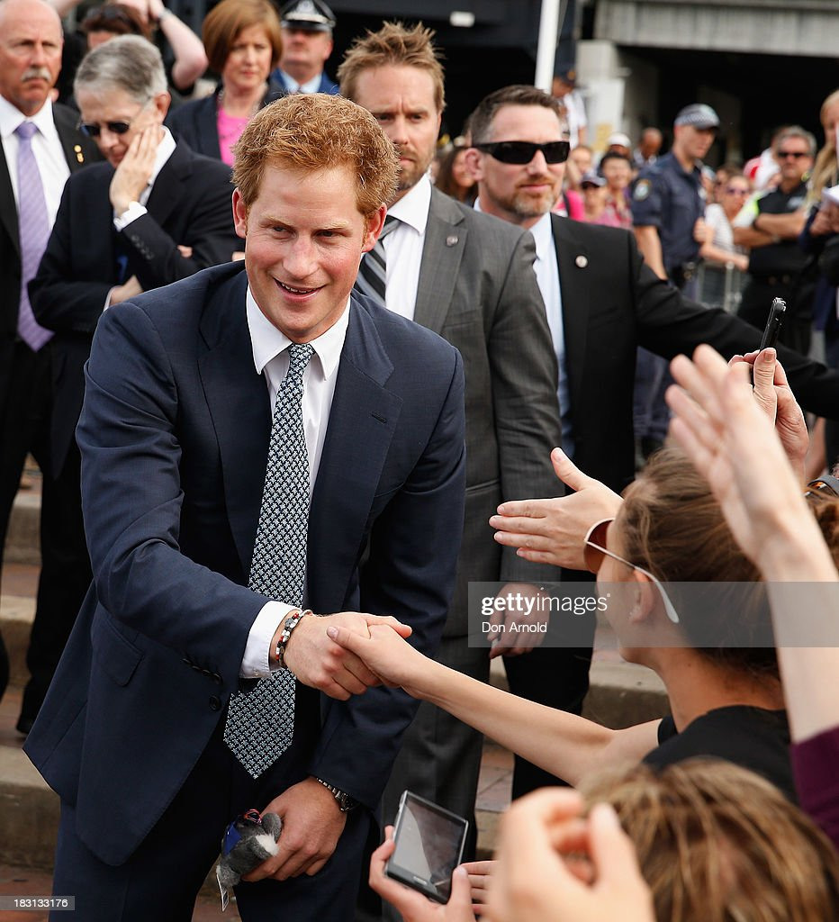 <a gi-track='captionPersonalityLinkClicked' href=/galleries/search?phrase=Prince+Harry&family=editorial&specificpeople=178173 ng-click='$event.stopPropagation()'>Prince Harry</a> greets fans at Campbell Cove on October 5, 2013 in Sydney, Australia. Over 50 ships participate in the International Fleet Review at Sydney Harbour to commemorate the 100 year anniversary of the Royal Australian Navy's fleet arriving into Sydney. <a gi-track='captionPersonalityLinkClicked' href=/galleries/search?phrase=Prince+Harry&family=editorial&specificpeople=178173 ng-click='$event.stopPropagation()'>Prince Harry</a> is an official guest of the Australian Government and will take part in the fleet review during his two-day visit to Australia.