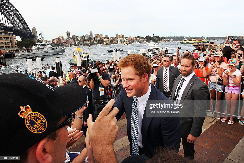 Prince Harry greets fans at Campbell Cove on October 5, 2013 in Sydney, Australia. Over 50 ships participate in the International Fleet Review at Sydney Harbour to commemorate the 100 year anniversary of the Royal Australian Navy's fleet arriving into Sydney. Prince Harry is an official guest of the Australian Government and will take part in the fleet review during his two-day visit to Australia.