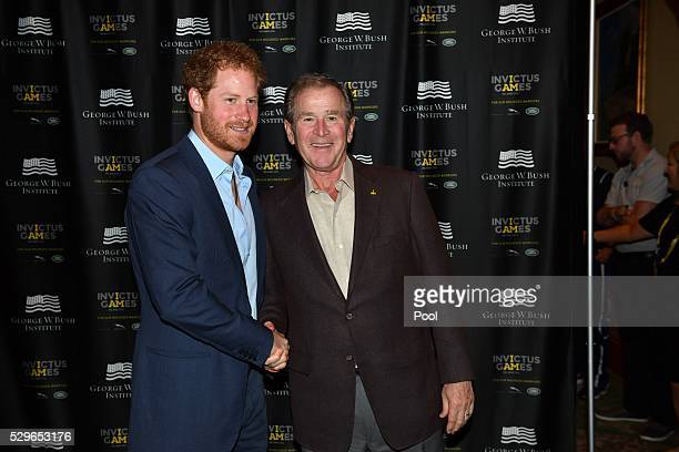 Prince Harry greets George W Bush during the Opening Ceremony of the Invictus Games Orlando 2016 at ESPN Wide World of Sports on May 8 2016 in...