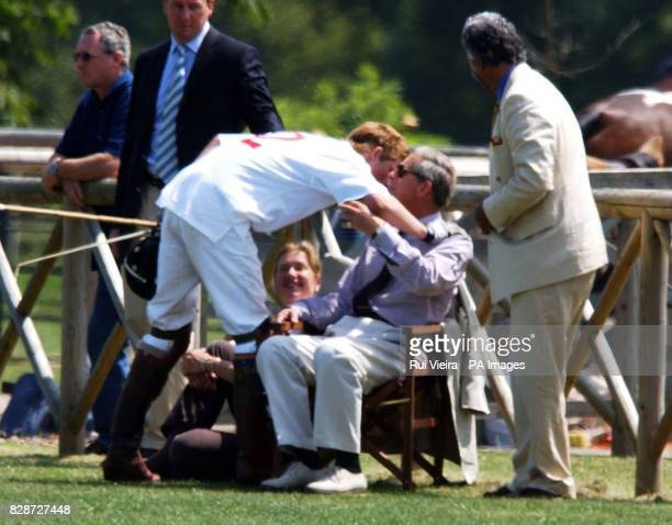 Prince Harry greets his father the Prince of Wales before captaining England against France at the National Schools Polo Tournament at Dallas Burston...