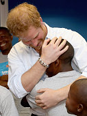 Prince Harry greets his old friend 16 yearold Relebohile 'Mutsu' Potsane who is singing as part of the Basotho Youth Choir made up of six boys and...