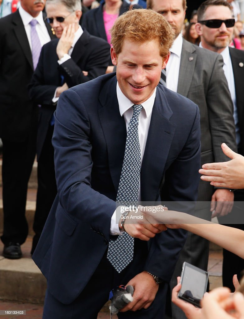 <a gi-track='captionPersonalityLinkClicked' href=/galleries/search?phrase=Prince+Harry&family=editorial&specificpeople=178173 ng-click='$event.stopPropagation()'>Prince Harry</a> greets members of the public at Campbell Cove on October 5, 2013 in Sydney, Australia. Over 50 ships participate in the International Fleet Review at Sydney Harbour to commemorate the 100 year anniversary of the Royal Australian Navy's fleet arriving into Sydney. <a gi-track='captionPersonalityLinkClicked' href=/galleries/search?phrase=Prince+Harry&family=editorial&specificpeople=178173 ng-click='$event.stopPropagation()'>Prince Harry</a> is an official guest of the Australian Government and will take part in the fleet review during his two-day visit to Australia.