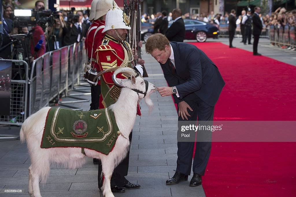 <a gi-track='captionPersonalityLinkClicked' href=/galleries/search?phrase=Prince+Harry&family=editorial&specificpeople=178173 ng-click='$event.stopPropagation()'>Prince Harry</a> greets Shenkin Reigmental Mascot of the 3rd Battalion The Royal Welsh and handler Goat Major SGT Jacko Jackson attend the 50th anniversary screening of Zulu at Odeon Leicester Square on June 10, 2014 in London, England.