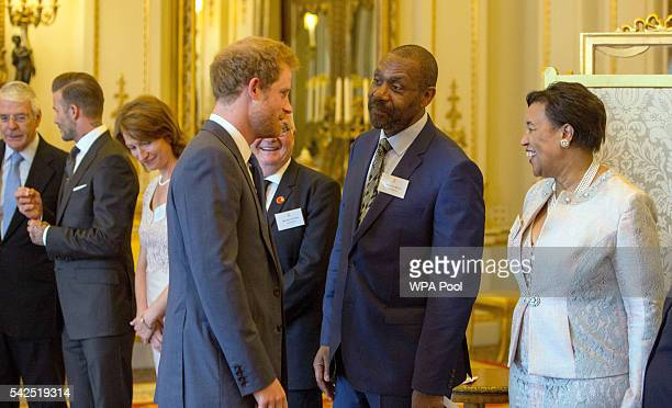 Prince Harry greets Sir Lenny Henry and Baroness Scotland of Asthal secretary general of the Commonwealth as Sir John Major and David Beckham talk...