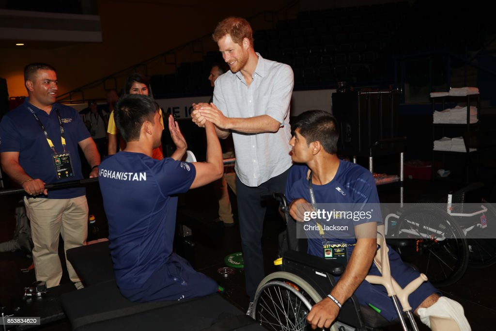 Prince Harry (C) greets the Afghan powerlifting team following powerlifting finals during the Invictus Games 2017 at Mattamy Athletics Centre on September 25, 2017 in Toronto, Canada
